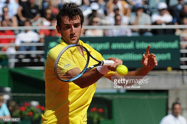 Marin Cilic of Croatia returns a ball to David Nalbandian during the match between Argentina and Croatia for the quarterfinals of the Davis Cup at...