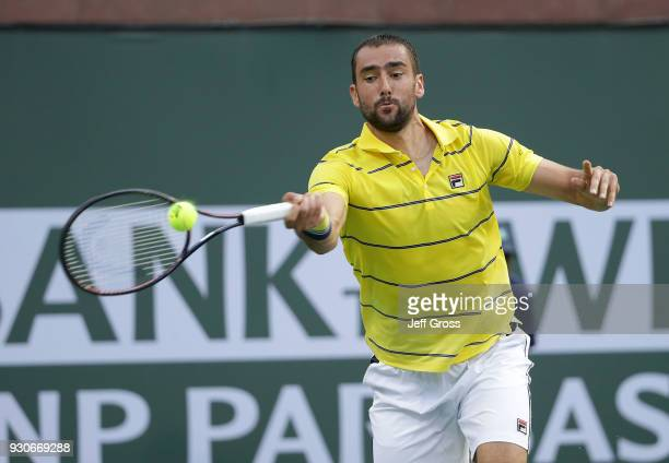 Marin Cilic of Croatia returns a forehand to Marton Fucsovics of Hungary during the BNP Paribas Open on March 11 2018 at the Indian Wells Tennis...