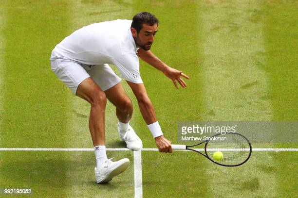 Marin Cilic of Croatia returns a shot against Guido Pella of Argentina during their Men's Singles second round match on day four of the Wimbledon...