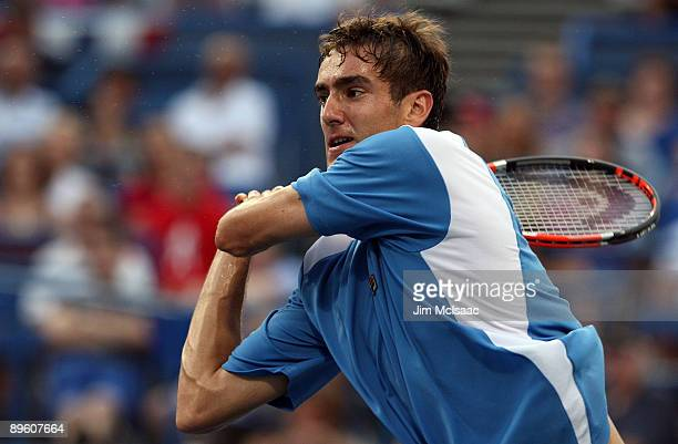 Marin Cilic of Croatia returns a shot against Somdev Devvarman of India during Day 2 of the Legg Mason Tennis Classic at the William H.G. FitzGerald...