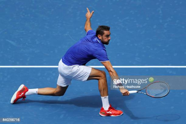 Marin Cilic of Croatia returns a shot during his first round Men's Singles match against Tennys Sandgren of the United States on Day One of the 2017...