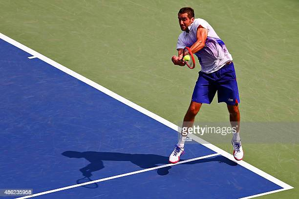 Marin Cilic of Croatia returns a shot during his Men's Singles Second Round match against Evgeny Donskoy of Russia on Day Three of the 2015 US Open...