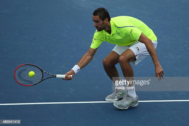 Marin Cilic of Croatia returns a shot to Alexander Zverev of Germany during the Citi Open at Rock Creek Park Tennis Center on August 7 2015 in...