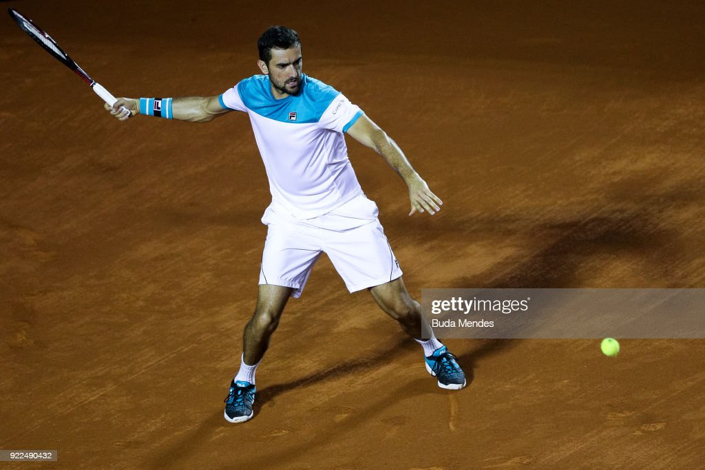 Marin Cilic of Croatia returns a shot to Gael Monfils of France during the ATP Rio Open 2018 at Jockey Club Brasileiro on February 21, 2018 in Rio de Janeiro, Brazil.