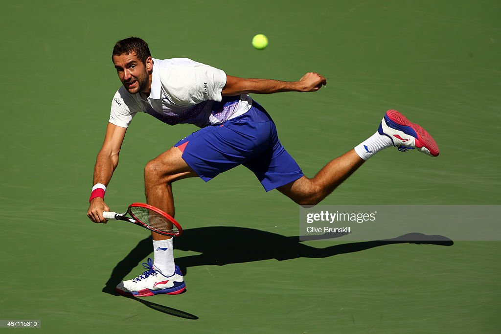 Marin Cilic of Croatia returns a shot to Jeremy Chardy of France during their Men's Singles Fourth Round match on Day Seven of the 2015 US Open at the USTA Billie Jean King National Tennis Center on September 6, 2015 in the Flushing neighborhood of the Queens borough of New York City.