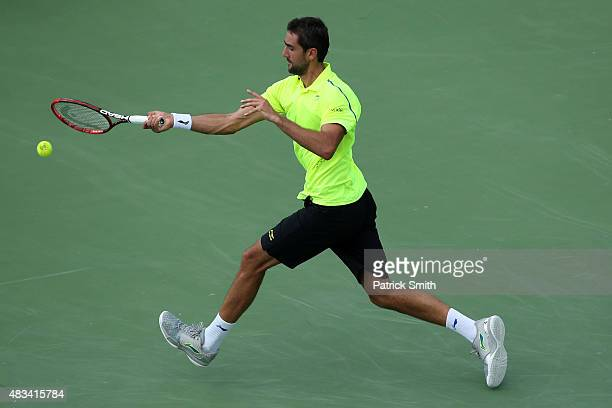 Marin Cilic of Croatia returns a shot to Kei Nishikori of Japan during the Citi Open at Rock Creek Park Tennis Center on August 8 2015 in Washington...