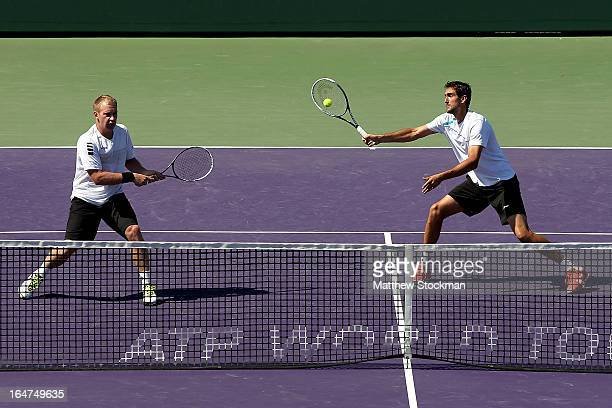 Marin Cilic of Croatia returns a shot to Marcel Granollers and Marc Lopez of Spain while playing with Lukas Dlouhy of Czech Republic during the Sony...