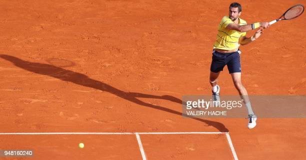 TOPSHOT Marin Cilic of Croatia returns the ball to Fernando Verdasco of Spain during the MonteCarlo ATP Masters Series Tournament on April 18 2018 in...