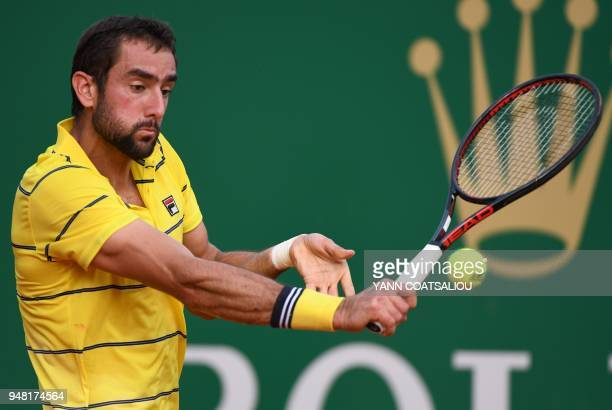 Marin Cilic of Croatia returns the ball to Fernando Verdasco of Spain during the Monte-Carlo ATP Masters Series Tournament, on April 18, 2018 in...