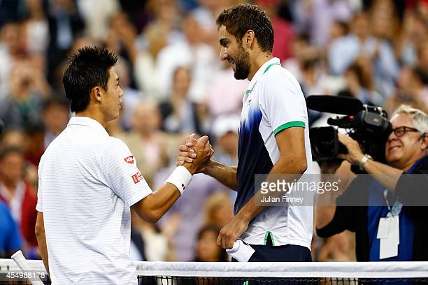 Marin Cilic of Croatia rgreets Kei Nishikori of Japan after their men's singles final match on Day fifteen of the 2014 US Open at the USTA Billie...
