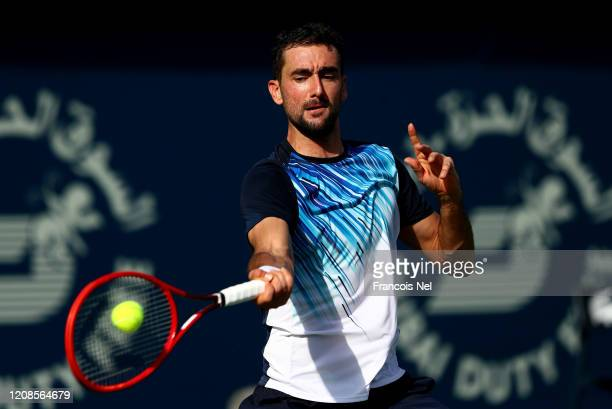 Marin Cilic of Croatia serve sagainst Benoit Paire of France his men's singles match on Day Nine of the Dubai Duty Free Tennis at Dubai Duty Free...