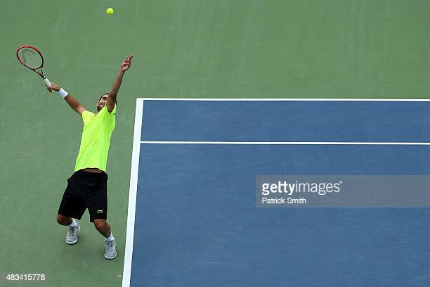 Marin Cilic of Croatia serves a shot to Kei Nishikori of Japan during the Citi Open at Rock Creek Park Tennis Center on August 8 2015 in Washington DC