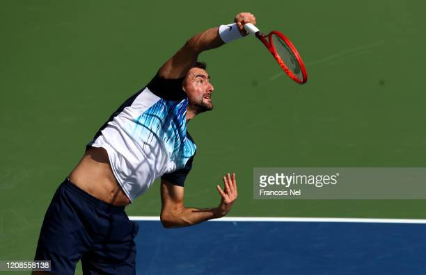Marin Cilic of Croatia serves against Benoit Paire of France during his men's singles match on Day Nine of the Dubai Duty Free Tennis at Dubai Duty...