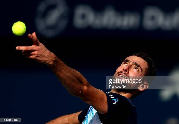 Marin Cilic of Croatia serves against Benoit Paire of France his men's singles match on Day Nine of the Dubai Duty Free Tennis at Dubai Duty Free...