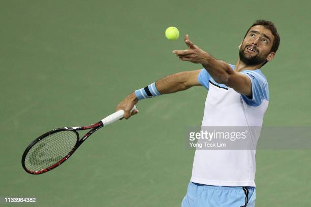 Marin Cilic of Croatia serves against David Goffin of Belgium in the first round of the Eisenhower Cup a Tie Break Tens event on Day 2 of the BNP...