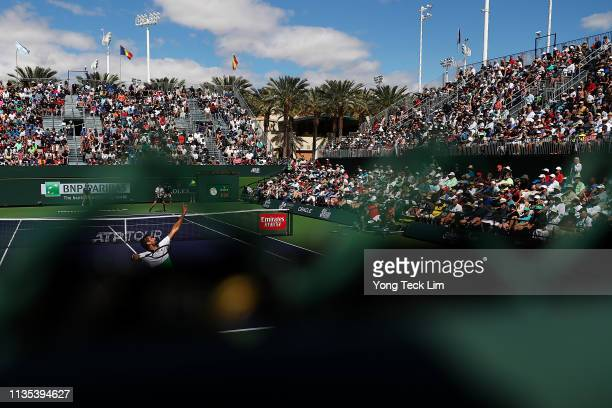 Marin Cilic of Croatia serves against Denis Shapovalov of Canada during their men's singles third round match on Day 9 of the BNP Paribas Open at the...