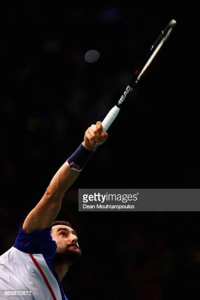 Marin Cilic of Croatia serves against Julien Benneteau of France during Day 5 of the Rolex Paris Masters held at the AccorHotels Arena on November 3...