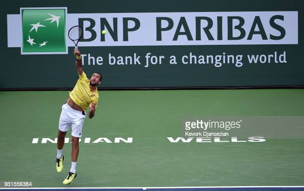Marin Cilic of Croatia serves against Philipp Kohlschreiber of Germany during Day 9 of BNP Paribas Open on March 13 2018 in Indian Wells California