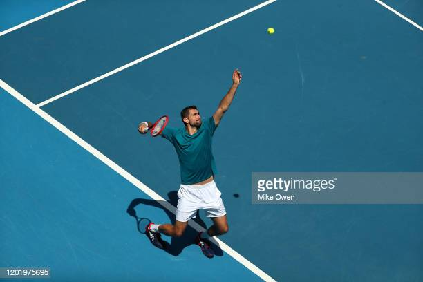 Marin Cilic of Croatia serves during his Men's Singles fourth round match against Milos Raonic of Canada on day seven of the 2020 Australian Open at...