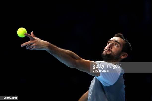 Marin Cilic of Croatia serves during his singles round robin match against John Isner of The United States during Day Four of the Nitto ATP Finals at...