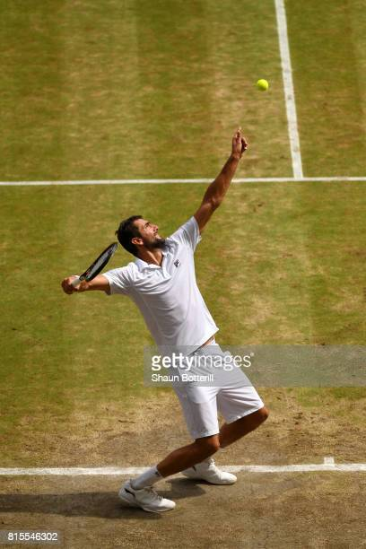 Marin Cilic of Croatia serves during the Gentlemen's Singles final against Roger Federer of Switzerland on day thirteen of the Wimbledon Lawn Tennis...