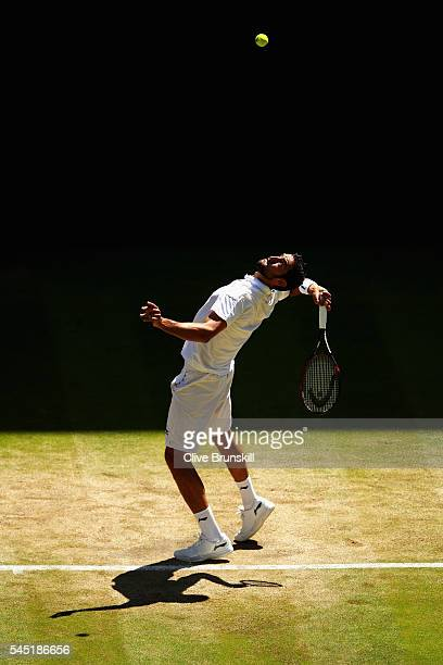 Marin Cilic of Croatia serves during the Men's Singles Quarter Finals match against Roger Federer of Switzerland on day nine of the Wimbledon Lawn...