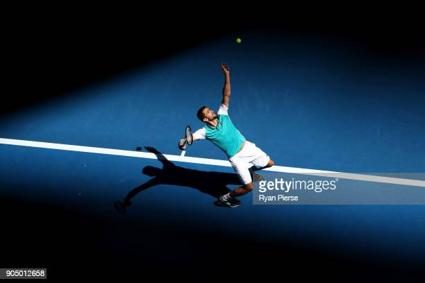 Marin Cilic of Croatia serves in his first round match against Vasek Pospisil of Canada on day one of the 2018 Australian Open at Melbourne Park on...