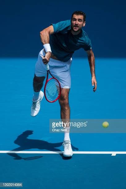 Marin Cilic of Croatia serves in his fourth round match against Milos Raonic of Canada on day seven of the 2020 Australian Open at Melbourne Park on...