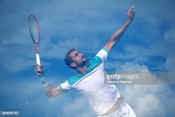 Marin Cilic of Croatia serves in his fourth round match against Pablo Carreno Busta of Spain on day seven of the 2018 Australian Open at Melbourne...