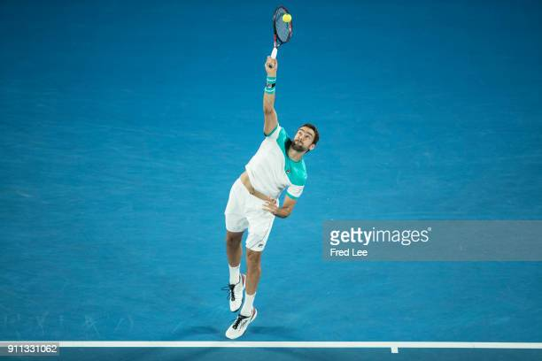 Marin Cilic of Croatia serves in his men's singles final match against Roger Federer of Switzerland on day 14 of the 2018 Australian Open at...