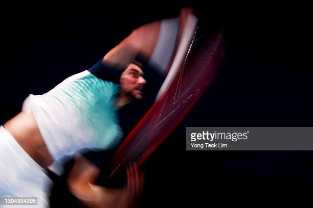 Marin Cilic of Croatia serves in his Men's Singles Semifinal match against Alexei Popyrin of Australia on day six of the Singapore Tennis Open at the...