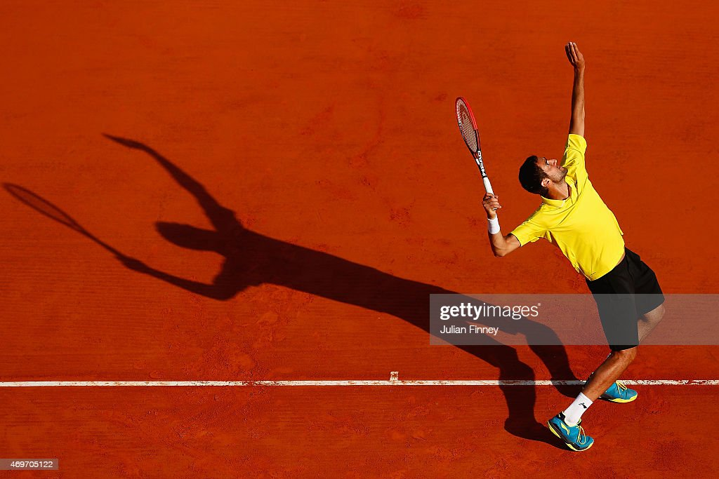 Marin Cilic of Croatia serves to Florian Mayer of Germany during day three of the Monte Carlo Rolex Masters tennis at the Monte-Carlo Sporting Club on April 14, 2015 in Monte-Carlo, Monaco.