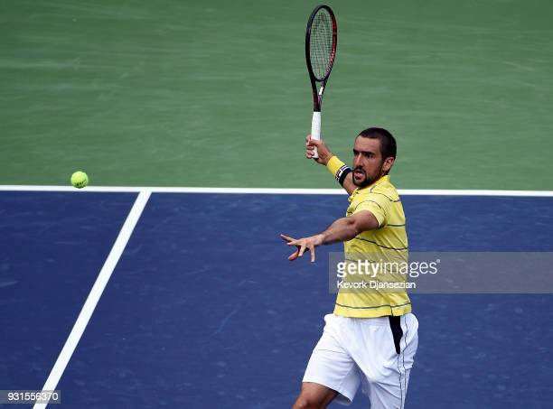 Marin Cilic of Croatia smashes a volley against Philipp Kohlschreiber of Germany during Day 9 of BNP Paribas Open on March 13 2018 in Indian Wells...