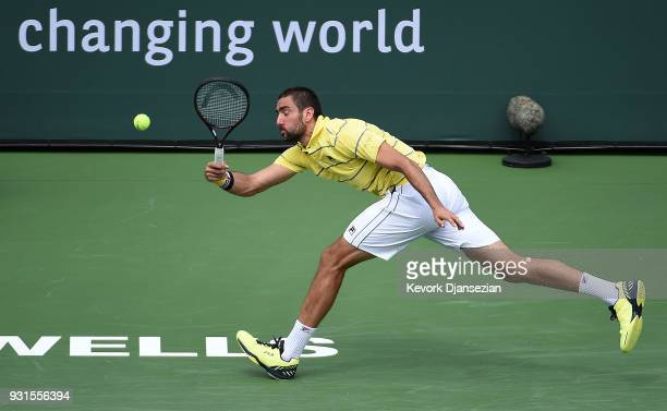 Marin Cilic of Croatia stretches for a forehand against Philipp Kohlschreiber of Germany during Day 9 of BNP Paribas Open on March 13 2018 in Indian...