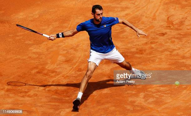 Marin Cilic of Croatia stretches for a forehand during his first round match against Andrea Basso of Italy during day three of the International BNL...