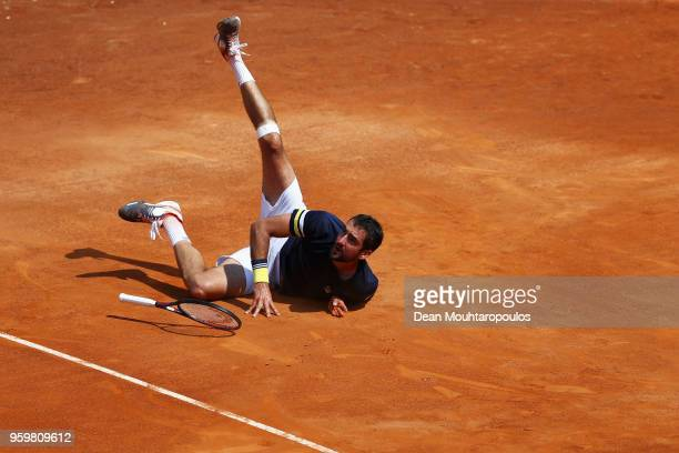 Marin Cilic of Croatia stumbles and falls in his quarter final match against Pablo Carreno Busta of Spain during day 6 of the Internazionali BNL...