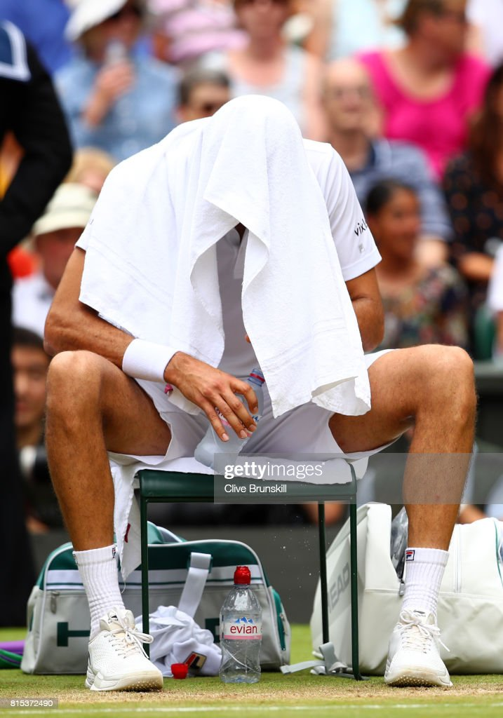 Marin Cilic of Croatia takes a break during the Gentlemen's Singles final against Roger Federer of Switzerland on day thirteen of the Wimbledon Lawn Tennis Championships at the All England Lawn Tennis and Croquet Club at Wimbledon on July 16, 2017 in London, England.