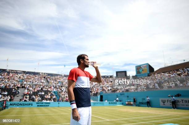 Marin Cilic of Croatia takes a drink during the semi final match against Nick Kyrgios of Australia during Day six of the FeverTree Championships at...