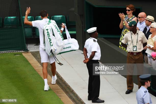 Marin Cilic of Croatia waves to the crowd after being Guido Pella of Argentina in their Men's Singles second round match on day four of the Wimbledon...