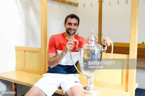 Marin Cilic of Croatia with the trophy after victory in the final match against Novak Djokovic of Serbia during Day seven of the FeverTree...