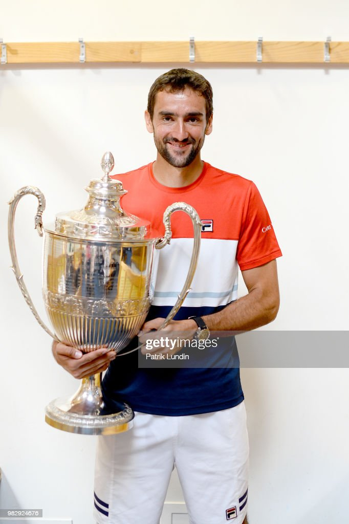 Marin Cilic of Croatia with the trophy after victory in the final match against Novak Djokovic of Serbia during Day seven of the Fever-Tree Championships at Queens Club on June 24, 2018 in London, United Kingdom.