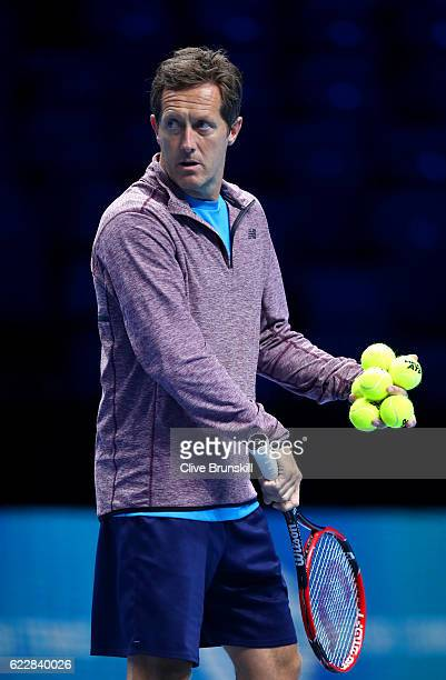 Marin Cilic of Croatia's coach Jonas Bjorkman watches a practice session during previews for the Barclays ATP World Tour Finals at O2 Arena on...