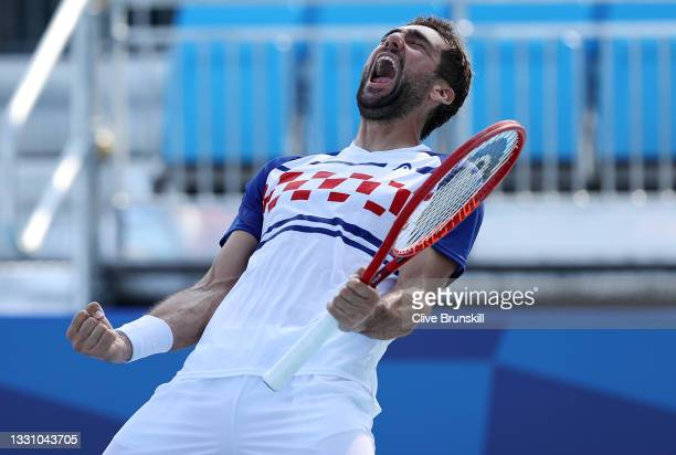 Marin Cilic of Team Croatia celebrates after match point during his Men's Doubles Quarterfinal match with Ivan Dodig of Team Croatia against Andy...