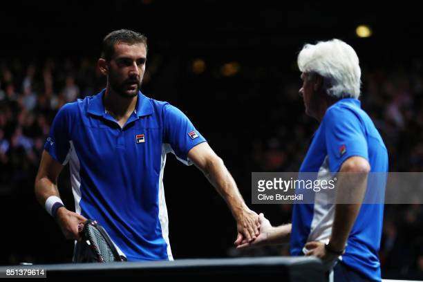 Marin Cilic of Team Europe celebrates with Bjorn Borg, Captain of Team Europe during his singles match against Frances Tiafoe of Team World on the...