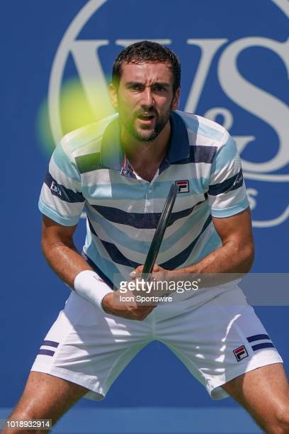 Marin Cilic prepares to return a serve from Novak Djokovic during the semifinal match at the Western Southern Open at the Lindner Family Tennis...