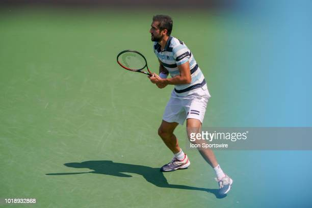 Marin Cilic prepares to return serve during the semifinal match at the Western Southern Open at the Lindner Family Tennis Center in Mason Ohio on...