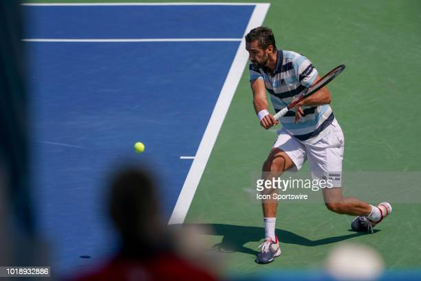 Marin Cilic returns a serve during the semifinal match at the Western Southern Open at the Lindner Family Tennis Center in Mason Ohio on August 18...