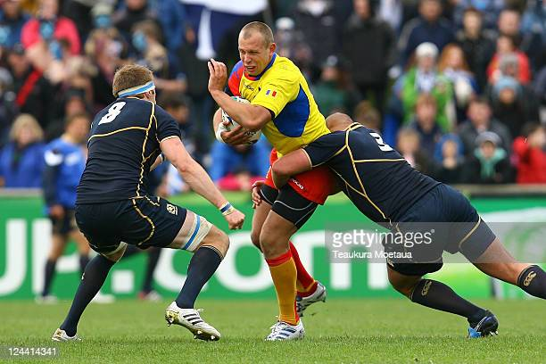 Marin Danut Dumbrava is tackled during the IRB 2011 Rugby World Cup Pool B match between Scotland and Romania at Rugby Park Stadium on September 10...