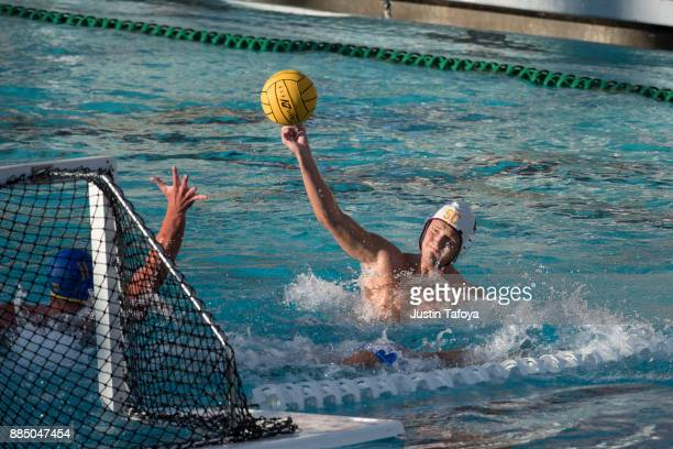 Marin Dasic of the University of Southern California shoots the ball during the Division I Men's Water Polo Championship held at the Uytengsu...