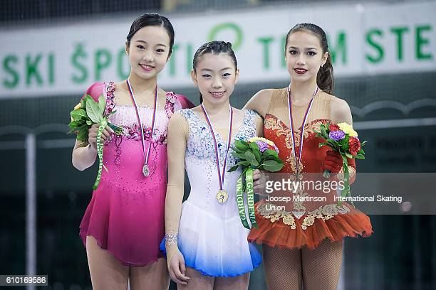 Marin Honda and Rika Kihira of Japan and Alina Zagitova of Russia pose for a photo during the Junior Ladies medal ceremony on day three of the ISU...